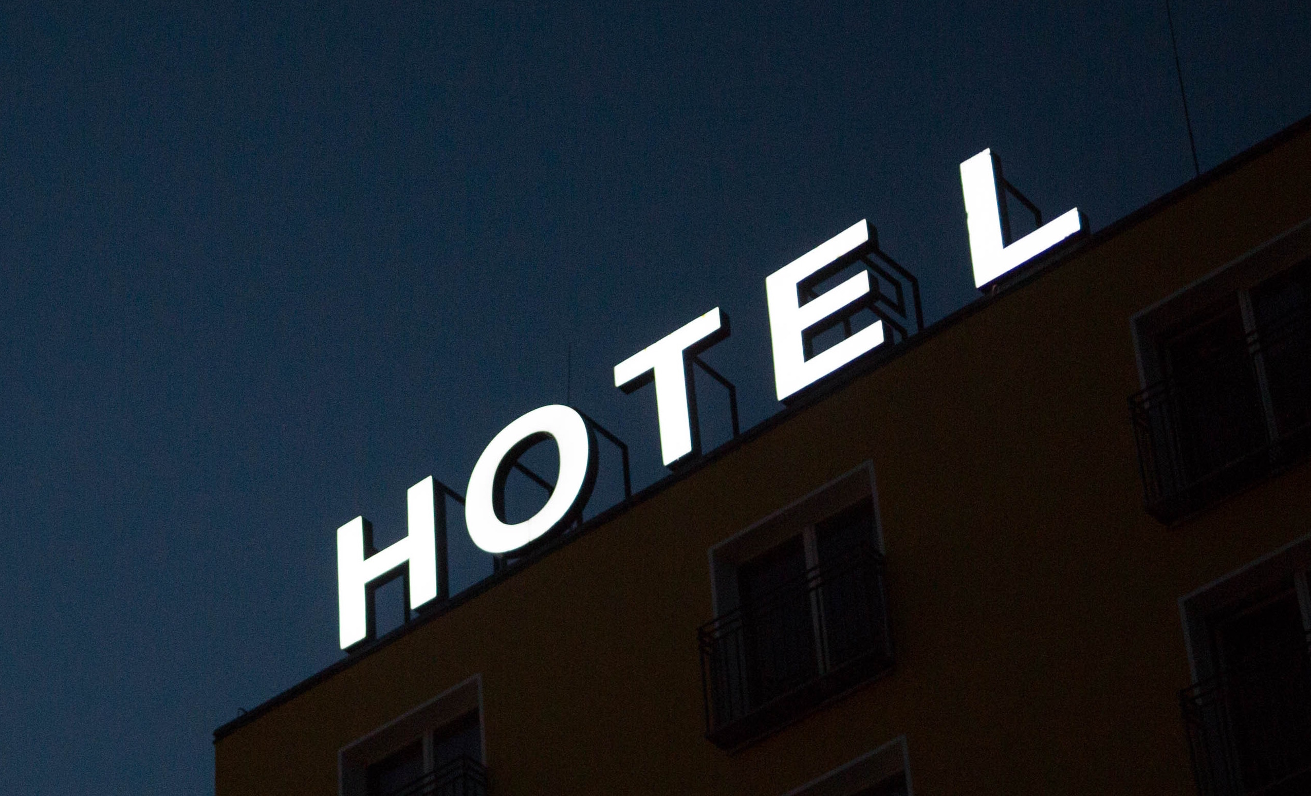 Sign on top of a hotel - saying Hotel